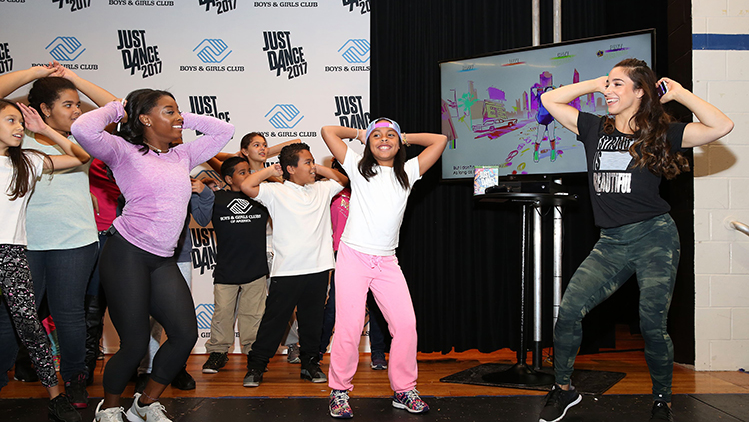 Olympic champs simone biles and aly raisman inspire with just dance 2017 the participants had a blast dancing along with biles and raisman and went wild when some were invited to join the gymnasts onstage m4hsunfo